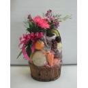 Panier avec chocolats et fleurs